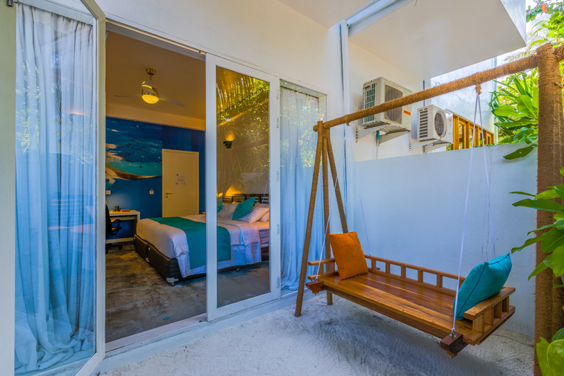 Boutique Beach Maldives Double Deluxe Bedroom Private Patio with Outdoor Swing