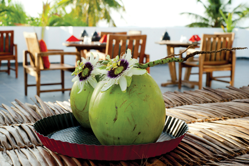 Boutique Beach Hotel  Welcome Drink Young Coconut with Passion Flower on Rood Terrace