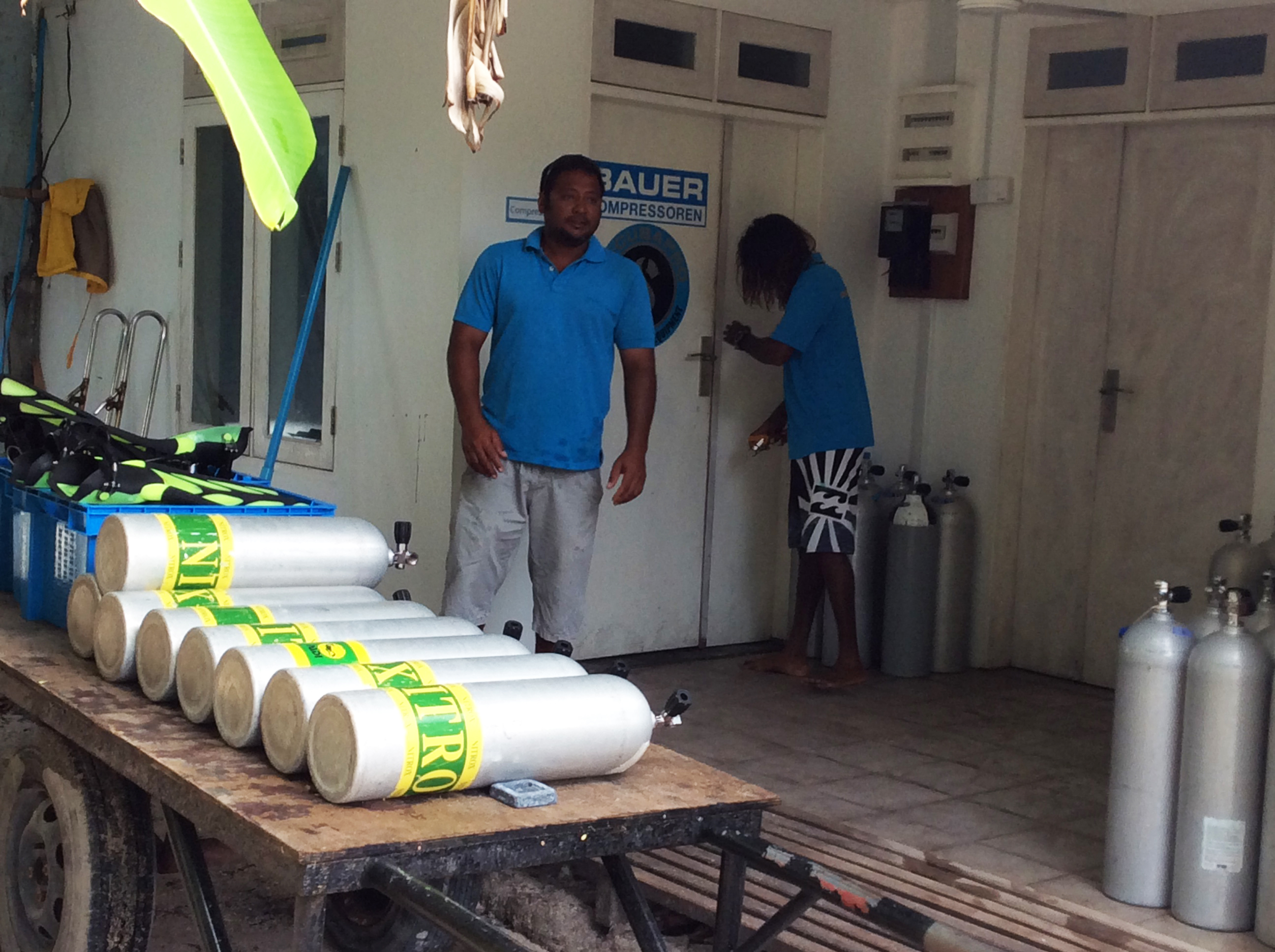 Boutique Beach Maldives Dive Team preparing Diving Equipment and Nitrox Tanks