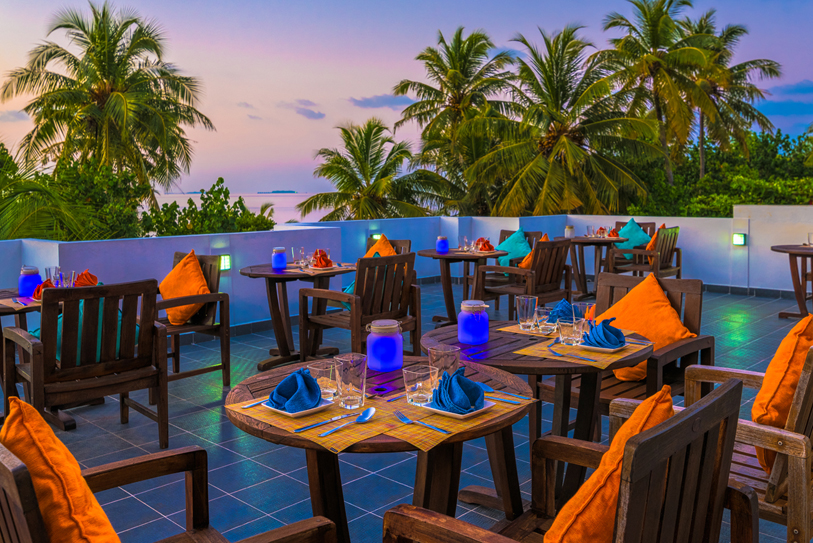 Boutique Beach Maldives Roof Terrace Restaurant with Tables laid in purple and orange
