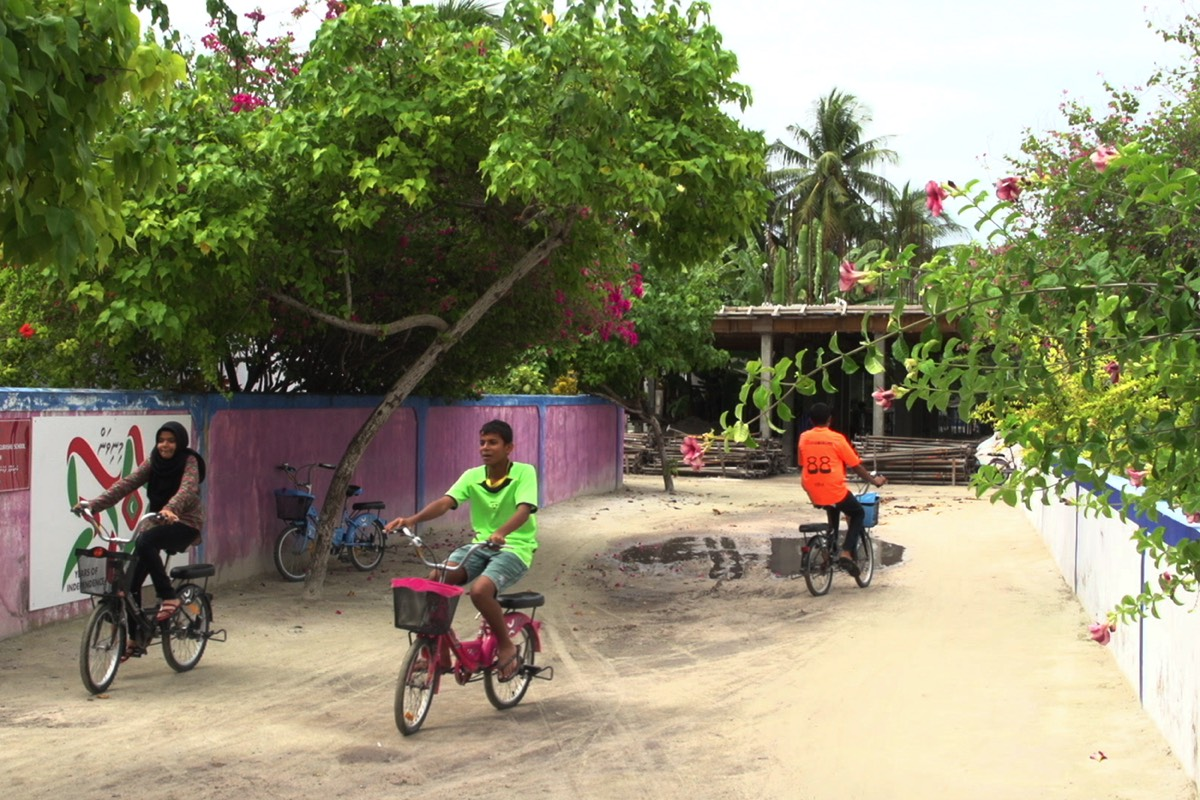 Boutique Beach Maldives Local Children riding bicycles on the island