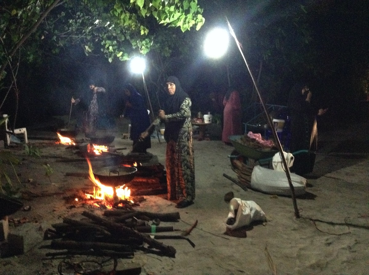 Boutique Beach Maldives Local Women Cooking Traditional Food on Open Fires Outdoors