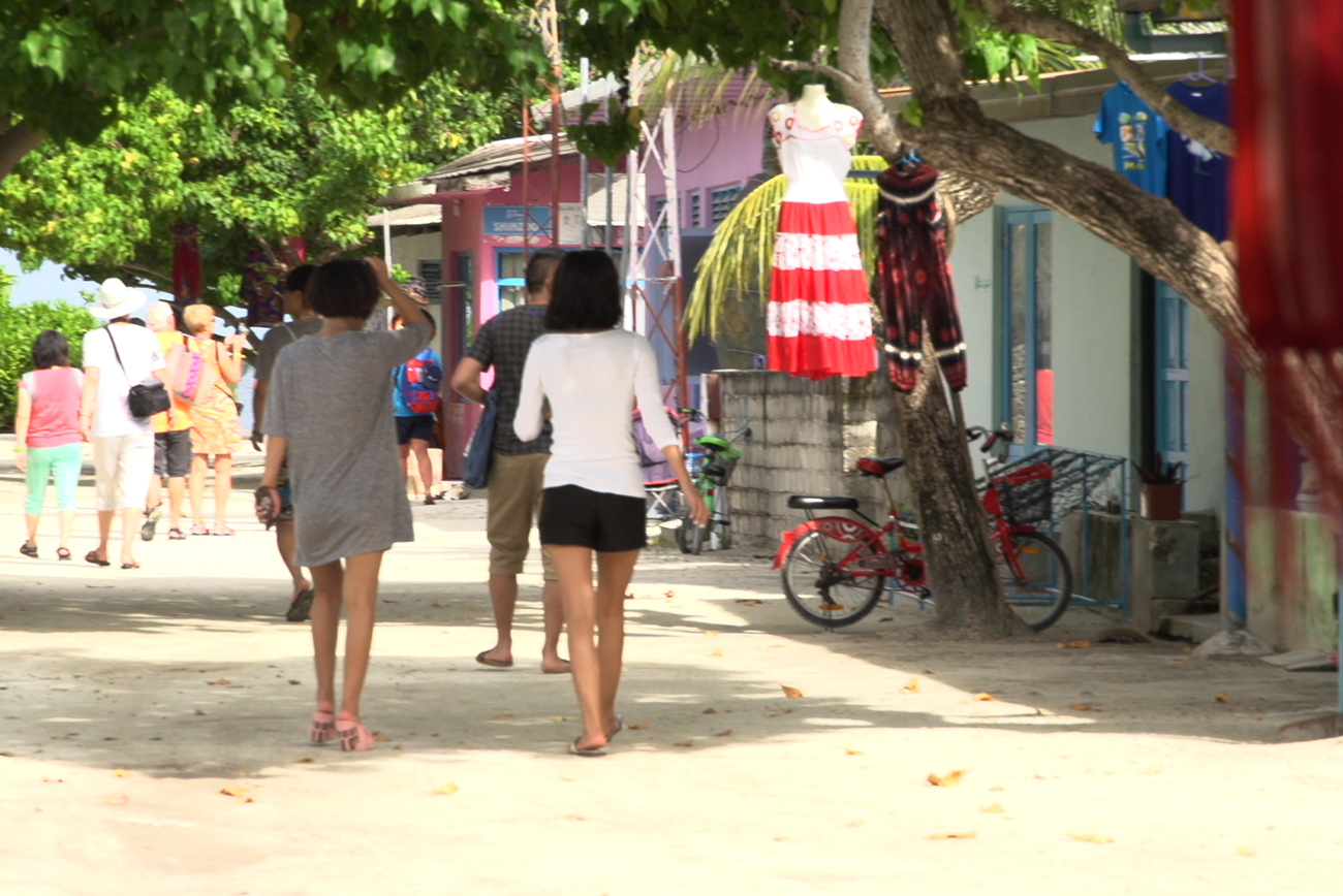 Boutique Beach Maldives Dhigurah Island Typical Street Scene with Tourists Strolling and Shopping
