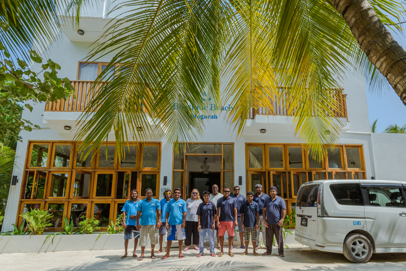 Boutique Beach Hotel Staff Group Photo outside the Hotel